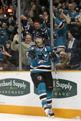 SAN JOSE, CA - MARCH 23:  Patrick Marleau #12 of the San Jose Sharks celebrates after he scored his second goal against the Calgary Flames after he scored a goal at the HP Pavilion on March 23, 2011 in San Jose, California.  (Photo by Ezra Shaw/Getty Imag