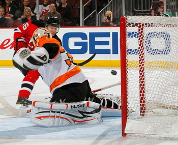 NEWARK, NJ - APRIL 01:  Goalie Brian Boucher #33 of the Philadelphia Flyers misses this shot by Patrik Elias #26 of the New Jersey Devils for his second goal of the night during the second period of an NHL hockey game at the Prudential Center on April 1,