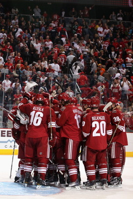 GLENDALE, AZ - MARCH 05:  The Phoenix Coyotes celebrate after defeating the Detroit Red Wings in the NHL game at Jobing.com Arena on March 5, 2011 in Glendale, Arizona. The Coyotes defeated the Red Wings 5-4 in an overtime shoot out.  (Photo by Christian