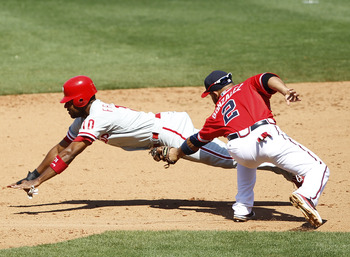 ATLANTA, GA - APRIL 10: Alex Gonzalez #2 of the Atlanta Braves tags out Ben Francisco #10 of the Philadelphia Phillies after he was caught stealing at Turner Field on April 10, 2011 in Atlanta, Georgia. The Phillies won 3-0. (Photo by Joe Robbins/Getty Im