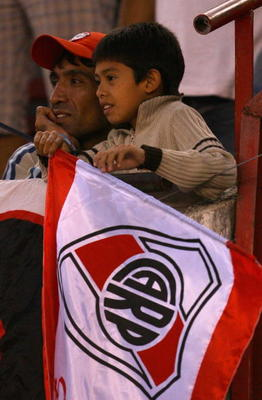 BUENOS AIRES, ARGENTINA - FEBRUARY 10:  River Plate fans watch the Primera Division closing season match between River Plate and Gimnasia de Jujuy at the Estadio Monumental on February 10, 2008 in Buenos Aires, Argentina.  (Photo by Julian Finney/Getty Im