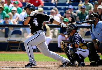 PHOENIX, AZ - MARCH 17:  Carlos Quentin #20 of the Chicago White Sox at bat against the Milwaukee Brewers during the spring training game at Maryvale Baseball Park on March 17, 2011 in Phoenix, Arizona.  (Photo by Kevork Djansezian/Getty Images)