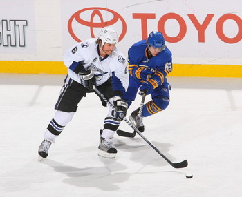 BUFFALO, NY - APRIL 05: Ryan Malone #6 of the Tampa Bay Lightning skates against Tyler Ennis #63 of the Buffalo Sabres  at HSBC Arena on April 5, 2011 in Buffalo, New York.  (Photo by Rick Stewart/Getty Images)