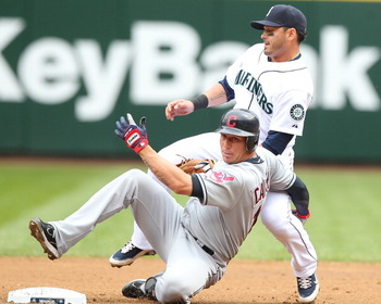 SEATTLE - APRIL 10:  Asdrubal Cabrera #13 of the Cleveland Indians is put out at second base by Luis Rodriguez #1 of the Seattle Mariners to end the top of the second inning at Safeco Field on April 10, 2011 in Seattle, Washington. (Photo by Otto Greule J
