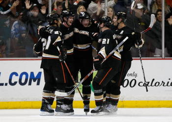 ANAHEIM, CA - NOVEMBER 03:  (L-R) Scott Niedermayer #27, Corey Perry #10, Bobby Ryan #9, Sheldon Brookbank #21 and Ryan Getzlaf #15 of the Anaheim Ducks celebrate Perry's second period goal against the Pittsburgh Penguins at the Honda Center on November 3