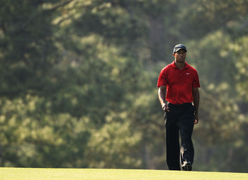AUGUSTA, GA - APRIL 10:  Tiger Woods walks up the 17th fairway during the final round of the 2011 Masters Tournament at Augusta National Golf Club on April 10, 2011 in Augusta, Georgia.  (Photo by Jamie Squire/Getty Images)