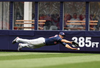 NEW YORK - APRIL 19:  Grady Sizemore #24 of the Cleveland Indians dives for a ball hit by Derek Jeter #2 of the New York Yankees at Yankee Stadium on April 19, 2009 in the Bronx borough of New York City.  (Photo by Ezra Shaw/Getty Images)