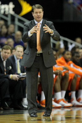 KANSAS CITY, MO - MARCH 10:  Head coach Travis Ford of the Oklahoma State Cowboys signals to his team against the Kansas Jayhawks during their quarterfinal game in the 2011 Phillips 66 Big 12 Men's Basketball Tournament at Sprint Center on March 10, 2011