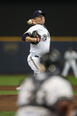 MILWAUKEE, WI - APRIL 04: Starting pitcher Chris Narveson #38 of the Milwaukee Brewers delivers the ball against the Atlanta Braves during the home opener at Miller Park on April 4, 2011 in Milwaukee, Wisconsin. The Braves defeated the Brewers 2-1.  (Phot