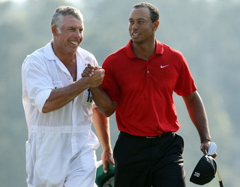 AUGUSTA, GA - APRIL 10:  Tiger Woods walks off the 18th green with his caddie Steve Williams during the final round of the 2011 Masters Tournament at Augusta National Golf Club on April 10, 2011 in Augusta, Georgia.  (Photo by Andrew Redington/Getty Image