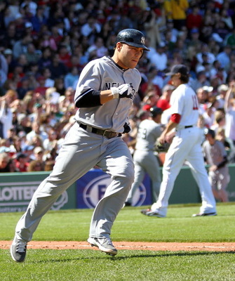 BOSTON, MA - APRIL 9:  Russell Martin #55 of the New York Yankees rounds the bases after he connected for a three-run home run against the Boston Red Sox in the first inning at Fenway Park April 9, 2011 in Boston, Massachusetts. (Photo by Jim Rogash/Getty