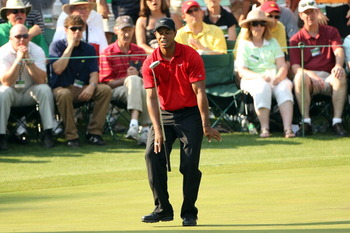 AUGUSTA, GA - APRIL 10:  Tiger Woods reacts to missing his putt on the 16th hole during the final round of the 2011 Masters Tournament at Augusta National Golf Club on April 10, 2011 in Augusta, Georgia.  (Photo by Andrew Redington/Getty Images)