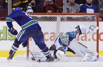 VANCOUVER, CANADA - JANUARY 20: Ryan Kesler #17 of the Vancouver Canucks is stopped by goalie Antti Niemi #31 of the San Jose Sharks during the shootout in NHL action on January 20, 2011 at Rogers Arena in Vancouver, BC, Canada.  (Photo by Rich Lam/Getty