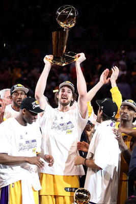 LOS ANGELES, CA - JUNE 17:  Pau Gasol #16 of the Los Angeles Lakers holds up the Larry O'Brien trophy after the Lakers defeated the Boston Celtics in Game Seven of the 2010 NBA Finals at Staples Center on June 17, 2010 in Los Angeles, California.  NOTE TO