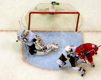 DETROIT - JUNE 12:  Marc-Andre Fleury #29 of the Pittsburgh Penguins makes a save with one second left in the game against the Detroit Red Wings during Game Seven of the 2009 NHL Stanley Cup Finals at Joe Louis Arena on June 12, 2009 in Detroit, Michigan.