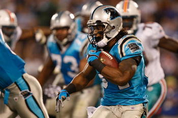 CHARLOTTE, NC - NOVEMBER 19:  DeAngelo Williams #34 of the Carolina Panthers runs with the ball against the Miami Dolphins during their game at Bank of America Stadium on November 19, 2009 in Charlotte, North Carolina.  (Photo by Streeter Lecka/Getty Imag