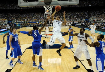HOUSTON, TX - APRIL 02:  Jeremy Lamb #3 of the Connecticut Huskies goes to the hoop agianst Terrence Jones #3 of the Kentucky Wildcats during the National Semifinal game of the 2011 NCAA Division I Men's Basketball Championship at Reliant Stadium on April