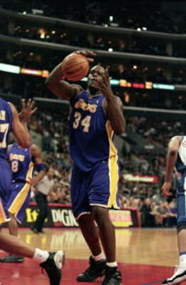 30 Dec 2000:  Shaquille O''Neal #34 of the Los Angeles Lakers catches the ball during the game against the Los Angeles Clippers at the STAPLES Center in Los Angeles, California.  The Lakers defeated the Clippers 116-114.  NOTE TO USER: It is expressly und