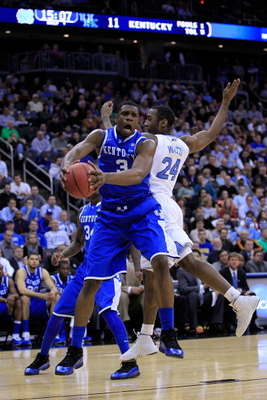 NEWARK, NJ - MARCH 27:  Terrence Jones #3 of the Kentucky Wildcats catches the ball against Justin Watts #24 of the North Carolina Tar Heels during the first half of the east regional final of the 2011 NCAA men's basketball tournament at Prudential Center