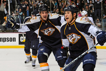 NASHVILLE, TN - MARCH 24:   Shane O'Brien #55 of the Nashville Predators congratulates teammate Jordin Tootoo #22 on scoring a goal against the Anaheim Ducks on March 24, 2011 at the Bridgestone Arena in Nashville, Tennessee.  (Photo by Frederick Breedon/