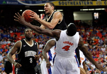 ATLANTA, GA - MARCH 12:  Jeffery Taylor #44 of the Vanderbilt Commodores goes up for a shot against Patric Young #4 of the Florida Gators during the semifinals of the SEC Men's Basketball Tournament at Georgia Dome on March 12, 2011 in Atlanta, Georgia.