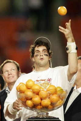 MIAMI - JANUARY 4:  Quarterback Matt Leinart #11 of the USC Trojans celebrates by throwing oranges after defeating the Oklahoma Sooners 55-19 to win the FedEx Orange Bowl 2005 National Championship on January 4, 2005 at Pro Player Stadium in Miami, Florid