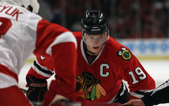 CHICAGO, IL - APRIL 10: Jonathan Toews #19 of the Chicago Blackhawks awaits a face-off against the Detroit Red Wings at the United Center on April 10, 2011 in Chicago, Illinois. The Red Wings defeated the Blackhawks 4-3  (Photo by Jonathan Daniel/Getty Im