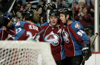 DENVER - DECEMBER 23:  Paul Stastny #26 of the Colorado Avalanche is congratulated for his first period goal against the Phoenix Coyotes by teamate Ryan Smyth #94 during NHL action at the Pepsi Center on December 23, 2008 in Denver, Colorado.  (Photo by D