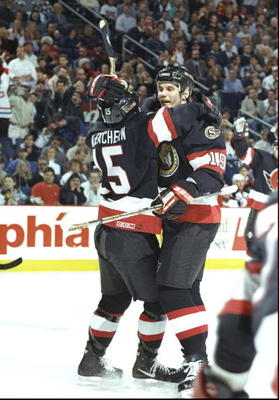 25 Apr 1997:  Centers Shawn McEachern and Alexei Yashin of the Ottawa Senators celebrate during a playoff game against the Buffalo Sabres at the Marine Midland Arena in Buffalo, New York.  The Senators won the game 4-1. Mandatory Credit: Rick Stewart  /Al