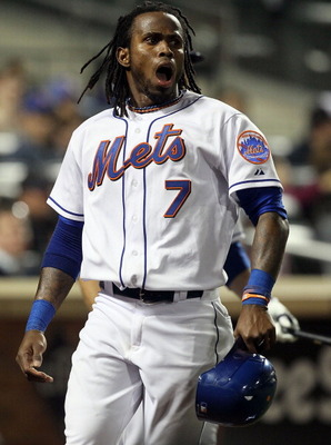 NEW YORK, NY - APRIL 11:  Jose Reyes #7 of the New York Mets celebrates after scoring a run in the third inning against the Colorado Rockies on April 11, 2011 at Citi Field in the Flushing neighborhood of the Queens borough of New York City.  (Photo by Ji