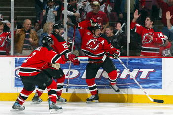 EAST RUTHERFORD, NJ - APRIL 28:  Jamie Langenbrunner #15 of the New Jersey Devils celebrates his double overtime game winning goal with Zach Parise #9 and Travis Zajac #19 to defeat the Ottawa Senators 3-2 to win Game 2 of the 2007 Eastern Conference Semi