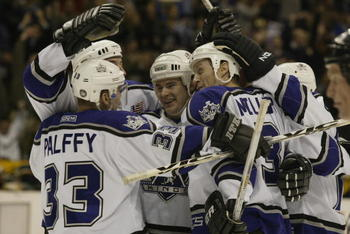 LOS ANGELES - JANUARY 24:  Adam Deadmarsh #28 (m) of the Los Angeles Kings celebrates with teammates Ziggy Palffy #33, Jason Allison (rear), Aaron Miller #3 and Lubomir Visnovsky (r) on a goal against the Minnesota Wild during the game on January 24, 2002