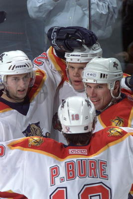 9 Jan 2002:  (l-r) Kristian Huselius #22,  Olli Jokinen #12, Paul Laus #3 and Pavel Bure #10 of the Florida Panthers celebrate during the game against the Dallas Stars at the National Car Rental Center in Miami Sunrise, Florida. The Stars win 3-2. DIGITAL