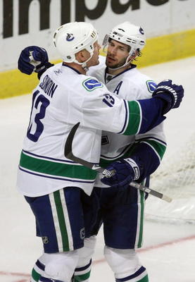 CHICAGO - MARCH 29: Mats Sundin #13 and Ryan Kesler #17 of the Vancouver Canucks celebrate a third period goal against the Chicago Blackhawks on March 29, 2009 at the United Center in Chicago, Illinois. The Canucks defeated the Blackhawks 4-0. (Photo by J