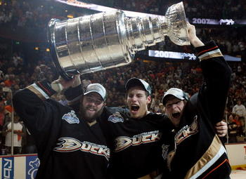 ANAHEIM, CA - JUNE 06:  (L-R) Dustin Penner #17, Ryan Getzlaf #15 and Corey Perry #10 of the Anaheim Ducks celebrate lifting the Stanley Cup after defeating the Ottawa Senators in Game Five of the 2007 Stanley Cup finals on June 6, 2007 at Honda Center in