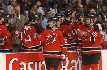 30 Mar 2002 :  Patrik Elias #26 of the New Jersey Devils and teammate Bobby Holik #16 pass by their  bench during the game against the Toronto Maple Leafs at Air Canada Centre in Toronto, Ontario, Canada. The Devils  won 4-1. DIGITAL IMAGE.  Mandatory Cre