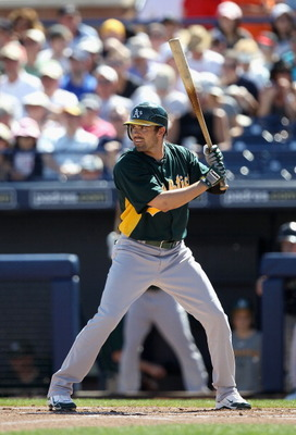 PEORIA, AZ - MARCH 12:  David DeJesus #12 of the Oakland Athletics bats against the Seattle Mariners during the spring training game at Peoria Stadium on March 12, 2011 in Peoria, Arizona.  (Photo by Christian Petersen/Getty Images)