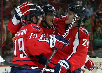 WASHINGTON DC, DC - SEPTEMBER 23:  Alex Ovechkin #8 of the Washington Capitals celebrates his second period goal against the Chicago Blackhawks with teammates Nicklas Backstrom #19 and Alexander Semin #28 during their preseason game on September 23, 2009