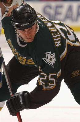TORONTO - MARCH 16:  Center Joe Nieuwendyk #25 of the Dallas Stars readies for the draw against the Toronto Maple Leafs during the NHL game at  Air Canada Centre in Toronto, Ontario, Canada. The Stars and Maple Leafs tied 5-5.  (Photo by Dave Sandford/Get