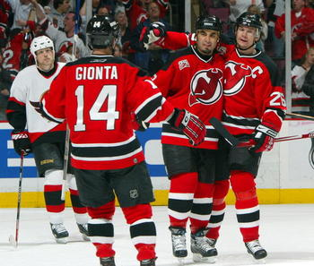 EAST RUTHERFORD, NJ - MAY 5: Scott Gomez #23 of the New Jersey Devils celebrates his first-period goal with teammates Brian Gionta #14 and Patrik Elias #26 against the Ottawa Senators during Game Five of the 2007 Eastern Conference Semifinals at the Conti