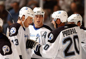 ATLANTA  -  OCTOBER 20 :  Vaclav Prospal #20, Pavel Kubina #13 and Vincent Lecavalier #4 of the Tampa Bay Lightning celebrate after a goal against the Atlanta Thrashers October 20, 2005 at Philips Arena in Atlanta, Georgia. The Lightning won the game 6-0.