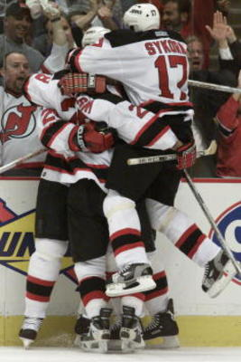 5 May 2001:  The New Jersey Devils celebrate following Jason Arnott's game-tying goal during the second period of game 5 of the NHL Eastern Conference Semifinals against the Toronto Maple Leafs at Continental Airlines Arena at the Meadowlands in East Ruth