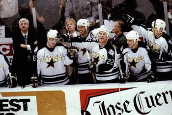 4 Jun 1999: Brett Hull #22 of the Dallas Stars with teammate Mike Modano #9 congradulate Jere Lehtinen #26  during game seven of the Western Confrence Finals against the Colorado Avalanche at the Reunion Arena in Dallas, Texas. The Stars defeated the Aval