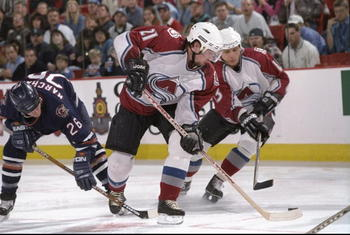 24 Apr 1998:  Center Peter Forsberg and leftwinger Valeri Kamensky of the Colorado Avalanche in action against leftwinger Todd Marchant of the Edmonton Oilers (lefT) during the playoffs round 1 game 2 at the Nichols Sports Arena in Denver, Colorado.  The