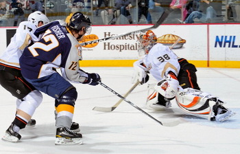 NASHVILLE, TN - MARCH 24:  Dan Ellis #39 of the Anaheim Ducks makes a save on Mike Fisher #12 of the Nashville Predators on March 24, 2011 at the Bridgestone Arena in Nashville, Tennessee.  (Photo by Frederick Breedon/Getty Images)