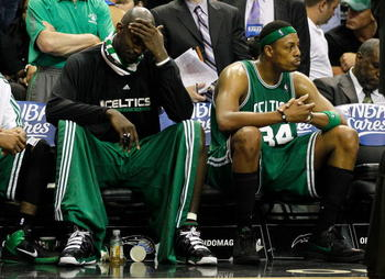 ORLANDO, FL - MAY 26:   Keivn Garnett #5 and Paul Pierce #34 of the Boston Celtics look on dejected from the bench in the final minutes of their 113-92 loss to the Orlando Magic in Game Five of the Eastern Conference Finals during the 2010 NBA Playoffs at