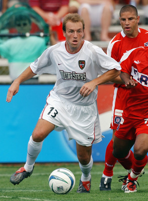 NAPERVILLE, IL - JUNE 28:  Andy Williams #16 of the Chicago Fire defends Clint Mathis #13 of the NY/NJ MetroStars during their MLS game on June 28, 2003 at Cardinal Stadium in Naperville, Illinois. The Fire defeated the MetroStars 2-1 in overtime. (Photo