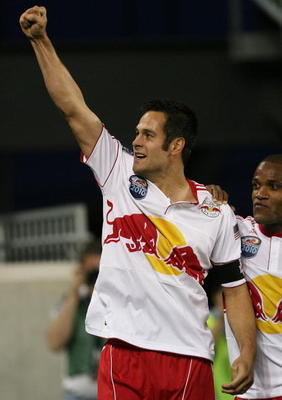 HARRISON, NJ - MARCH 20:  Mike Petke #12 of the New York Red Bulls celebrates his goal at 43rd minute against the Santos FC on March 20, 2010 at Red Bull Arena in Harrison, New Jersey.  (Photo by Chris Trotman/Getty Images for New York Red Bulls)