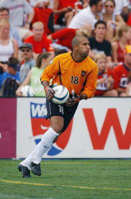 NAPERVILLE, IL - JUNE 28:  Goalkeeper Tim Howard #18 of the NY/NJ MetroStars looks to put the ball in play during their MLS game against the Chicago Fire on June 28, 2003 at Cardinal Stadium in Naperville, Illinois. The Fire defeated the MetroStars 2-1 in