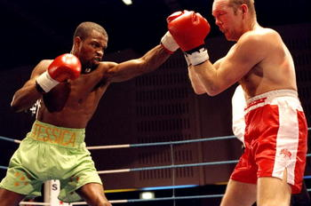 18 Dec 1993:  Duke McKenzie (left) and John Davison in action during their British Featherweight bout in Manchester, England. McKenzie won the bout to become the holder of the British Title. \ Mandatory Credit: John  Gichigi/Allsport